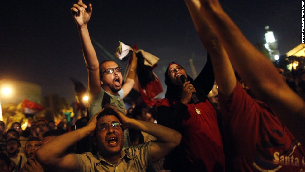 Protesters react after Morsy's speech in a street leading to the presidential palace in Cairo early on July 3. Morsy's angry opponents met head-on overnight with his supporters at Cairo University, leaving 23 people dead.