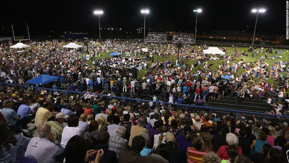 People attend a candlelight vigil at Prescott High School on July 2.