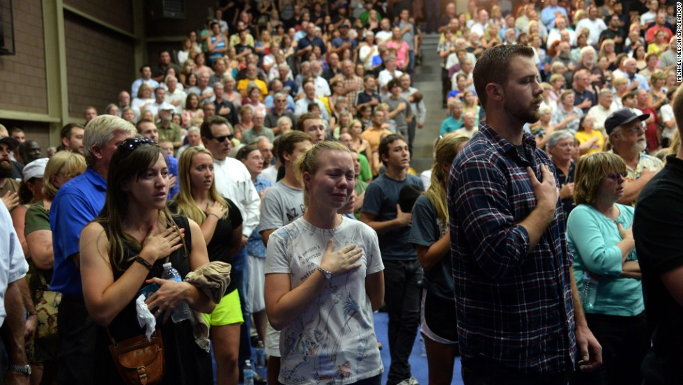 People gather at a memorial service for the firefighters at Embry-Riddle Aeronautical University in Prescott on Monday, July 1.