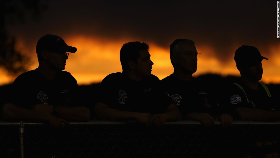 """JULY 2 - PRESCOTT, U.S.: People attend a candle lit vigil in honor of the <a href=""""http://cnn.com/interactive/2013/07/us/yarnell-fire/index.html"""">19 fallen firefighters</a> who died battling a <a href=""""http://cnn.com/2013/07/03/us/arizona-fire/index.html"""">fast-moving wildfire</a> near Yarnell, Arizona. The region has been suffering from an extreme drought, and the winds whipping through the mountains can blow embers into new patches of woodland and mesquite grass."""