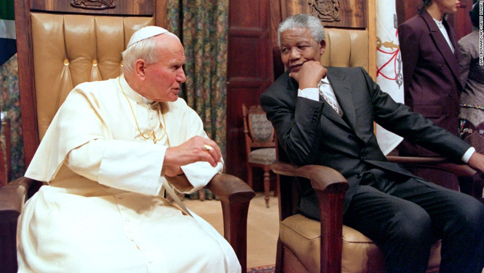 Pope John Paul II visits then-South African President Nelson Mandela at the presidential guesthouse in Pretoria, South Africa, in September 1995.