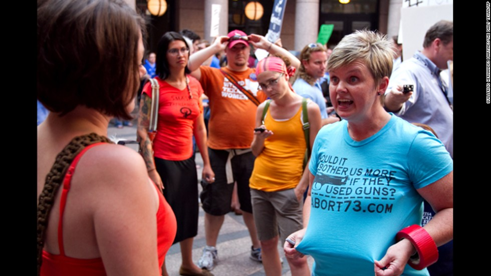 Anti-abortion activist Pamela Whitehead, right, argues with an abortion rights activist on July 2.