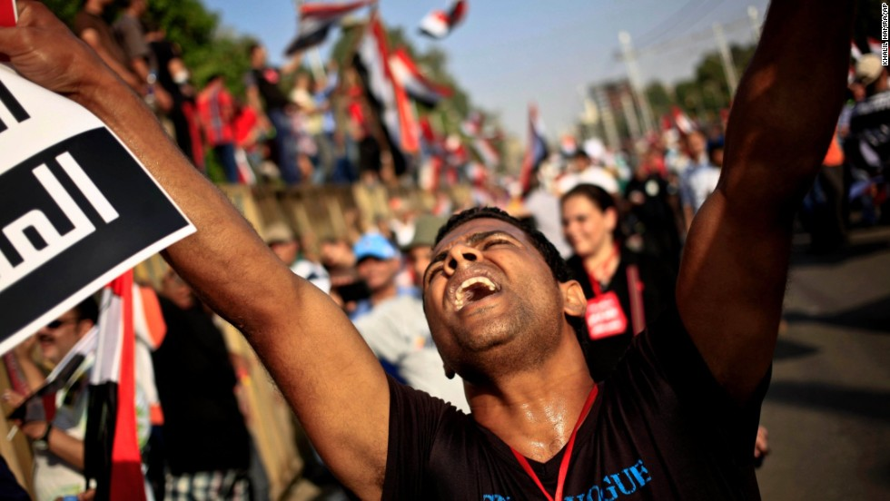 An opponent of Morsy chants slogans during a protest outside the presidential palace in Cairo on July 3.