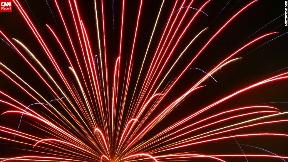 """Fitness instructor Tracy Bond loves the """"buzz"""" of Independence Day -- and the spectacular celebrations. """"A day off of work for many, picnics, maybe some time at the pool or lake -- and of course, at the end of the day, sonic booms followed by <a href=""""http://ireport.cnn.com/docs/DOC-996491"""">shimmering, multi-colored fire</a> bringing oohs and aahs from young and old. What's not to like?"""" she says."""
