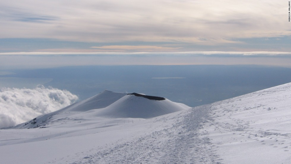 Mount Etna's vent is sometimes topped with snow during the winter.