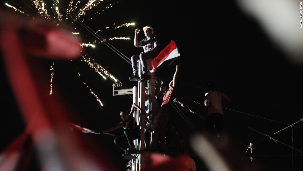 Protesters celebrate outside Egypt's Presidential Palace in Cairo on Wednesday, July 3.