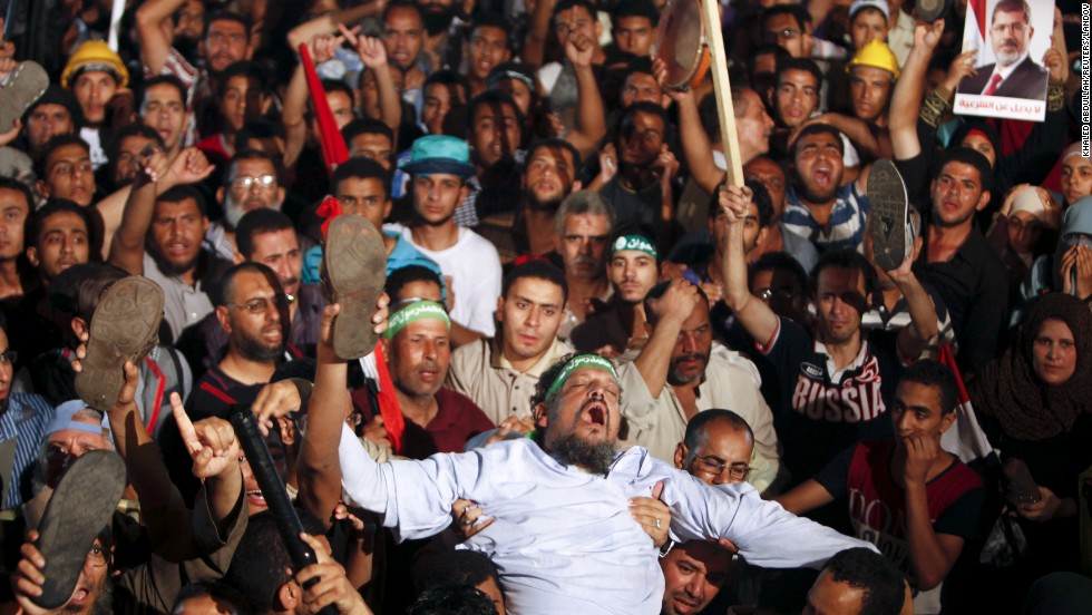 Members of the Muslim Brotherhood and Morsy supporters react at the Raba El-Adwyia mosque square on July 3 after the Egyptian Army's statement was announced on state TV.