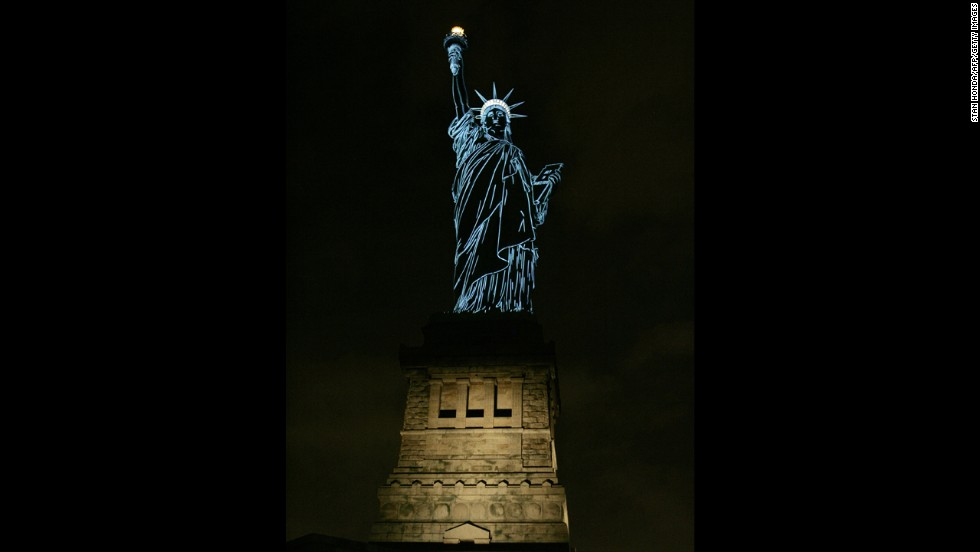 The Statue of Liberty is lit to show the contours of the sculpture in 2006, during a special show by French champagne maker Moet & Chandon.