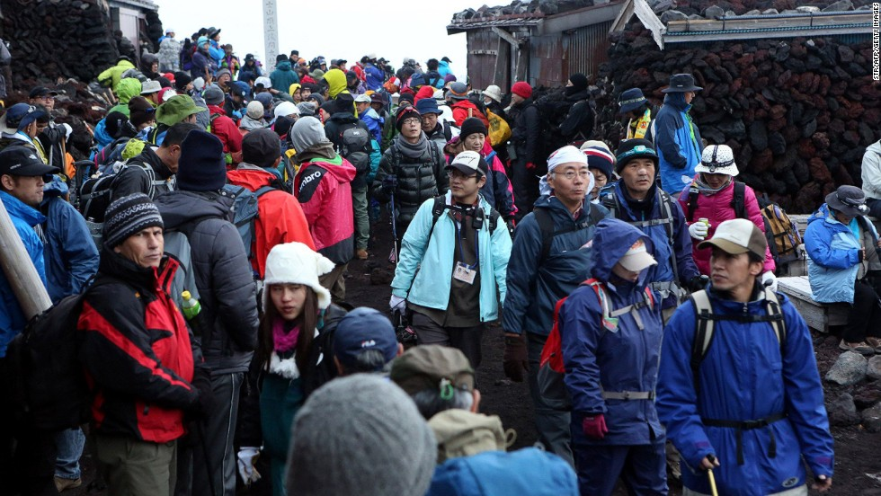 Climbers and trekkers swarmed over Mount Fuji on Monday, July 1, the first day of the summer climbing season. Officials expect to see far more climbers than usual this season, after the mountain's recent listing as a UNESCO World Heritage Site.