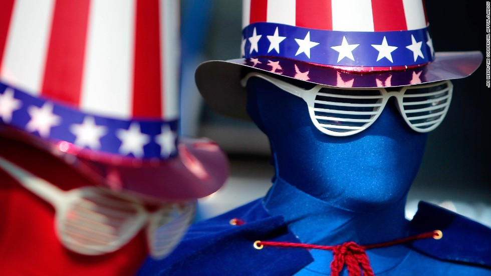 Decked out from head to toe in patriotism, 9-year-old Remi Schaber, left, and her brother Chase, 11, don spandex suits for the Independence Day parade in Cordova, Tennessee.