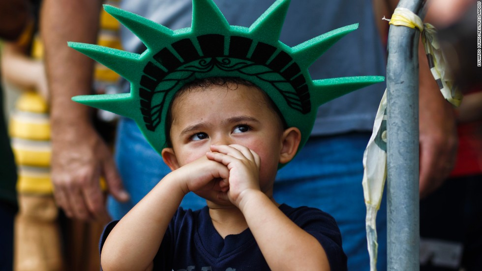 "A child attends a ceremony to reopen the <a href=""http://www.cnn.com/2013/07/03/us/gallery/statue-of-liberty/index.html"">Statue of Liberty</a> to the public in New York on July 4."
