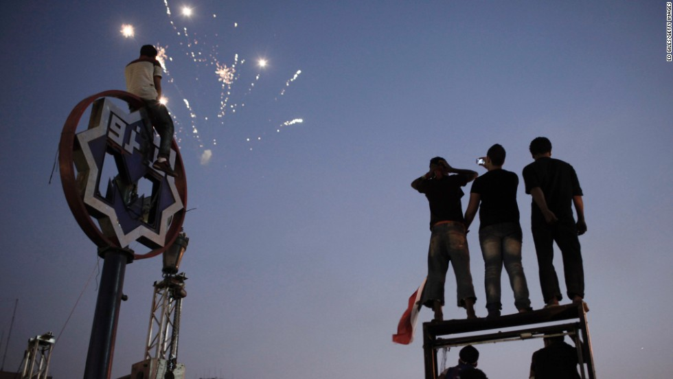 Egyptians watch fireworks in Tahrir Square on Thursday, July 4, the day after Morsy's ouster.