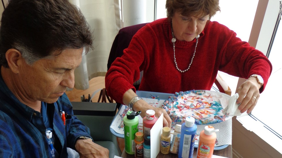"Max Chavez, a University of New Mexico Hospital cancer patient, and his wife, Beth, work on art projects. Chavez makes greeting cards and says the art projects give him ""something to do creatively that I wasn't doing because I was pretty depressed."""