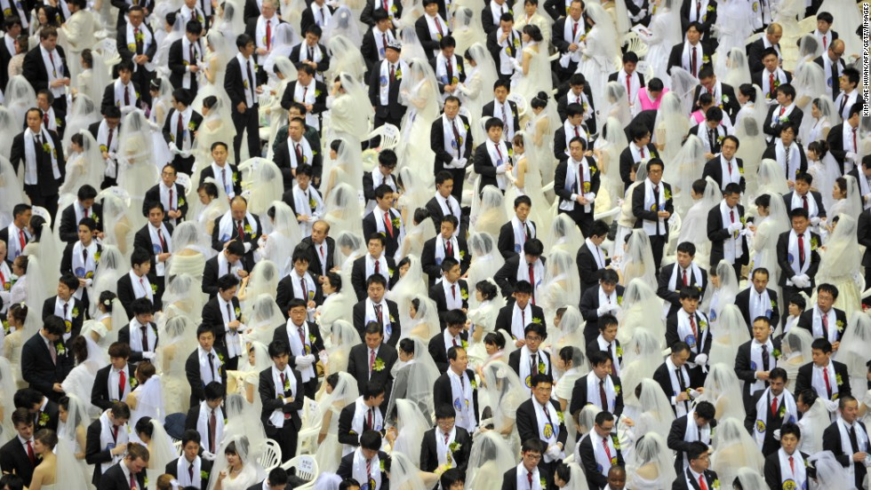Rows of newly wedded brides and grooms mingle at the Unification Church's mass wedding at its headquarters in Gapyeong, South Korea, on February 17, 2013. About 3,500 couples matched by the church tied the knot.
