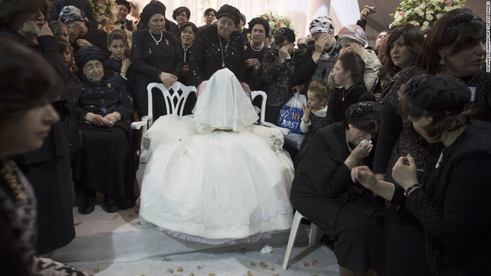 A Jewish bride is surrounded by relatives during her wedding to the great-grandson of the rabbi of the Tzanz Ultra-Orthodox Hasidic community in Netanya.