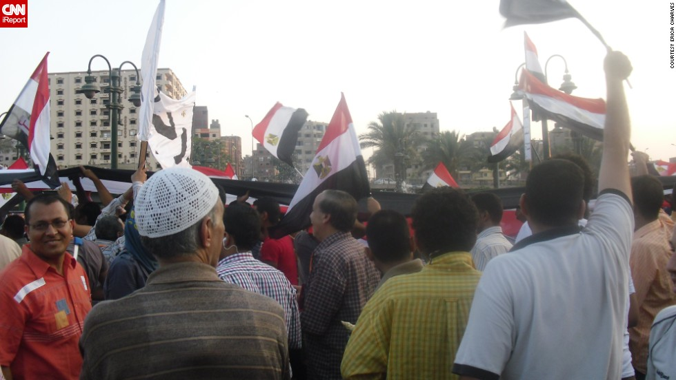 "Flags were ubiquitous throughout the protests, such as in this crowd in Cairo on Tuesday, July 2. ""A lot of my family [are] religious, so they pray that there will be peace in Egypt,"" said <a href=""http://ireport.cnn.com/docs/DOC-999156"">Charves</a>."
