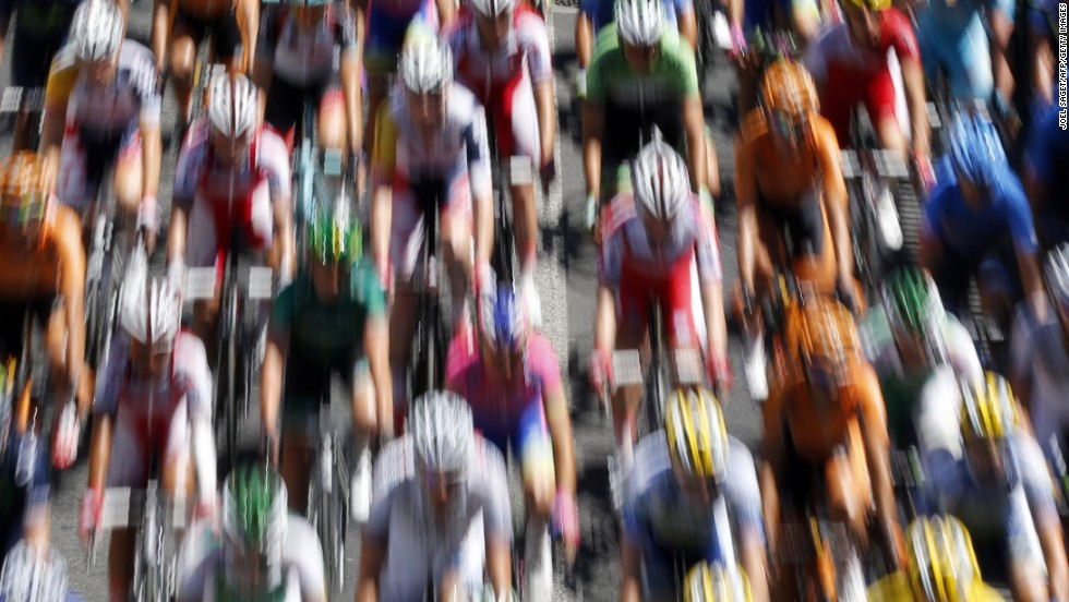 """JULY 5 - MONTPELIER AND ALBI, FRANCE: The pack rides during the 205.5 km seventh stage of the <a href=""""http://cnn.com/2013/06/28/worldsport/gallery/tour-de-france-in-pics"""">100th edition of the Tour de France </a>cycling race on July 5 between Montpellier and Albi, southwestern France. <a href=""""http://cnn.com/2013/07/04/sport/cycling-tour-impey-greipel-cavendish/?hpt=hp_bn2"""">Daryl Impey </a>became the first South African to don the famous yellow jersey as Andre Greipel powered to his first stage win."""