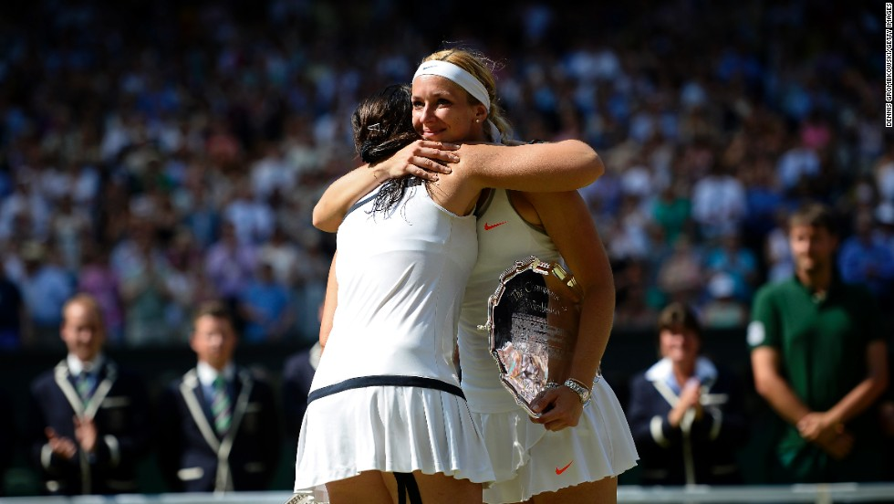 Bartoli and Lisicki share a sporting embrace during the awards ceremony.