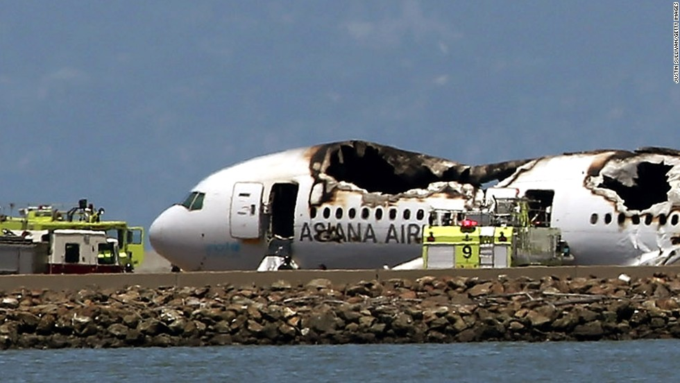 The Boeing 777 lies burned on the runway after it crashed landed on July 6.