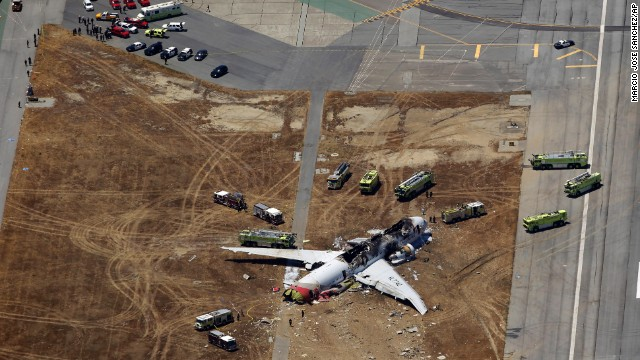 An aerial photo of the scene shows the extent of the plane's damage on July 6.