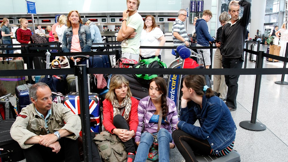 Passengers wait for the British Airways counter to reopen at San Francisco International Airport on July 6.