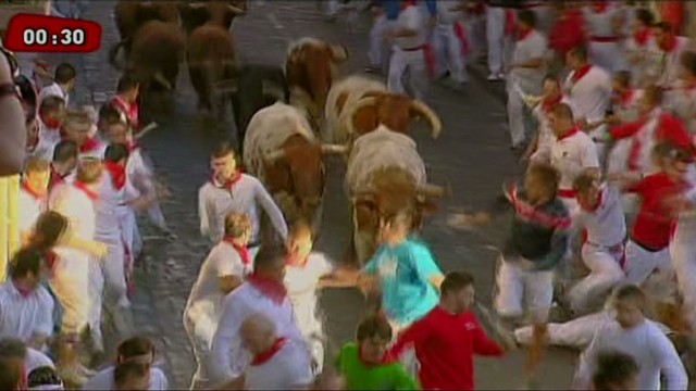 Thrill-seekers run with bulls in Spain