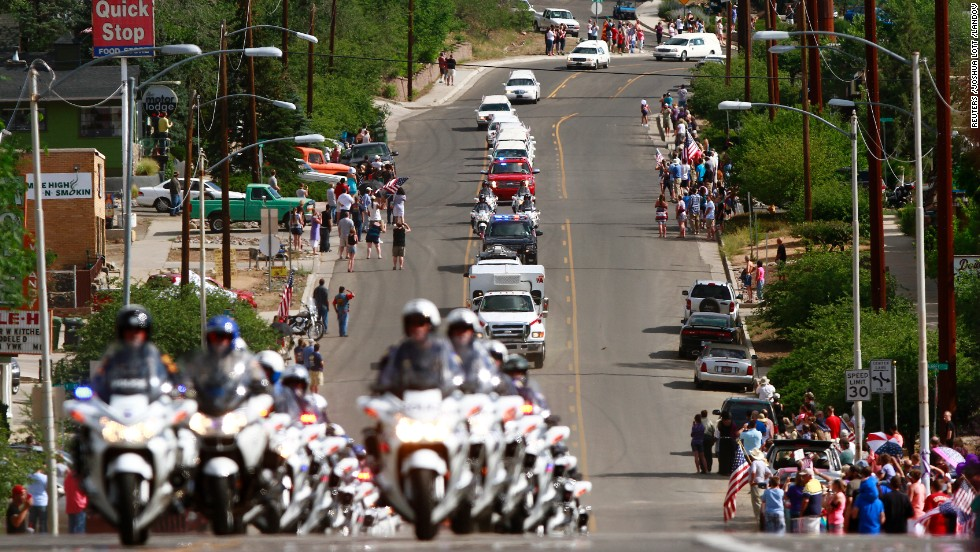 Nineteen white hearses carried the remains of the firefighters on July 7. They were accompanied by police motorcycle outriders on a final journey passing through the crew's hometown.