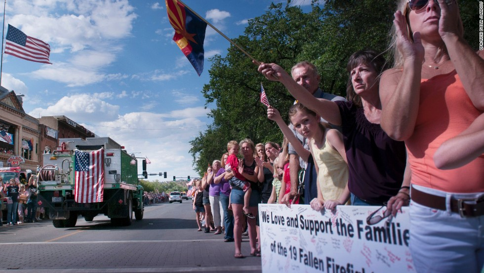Citizens of Prescott, Arizona, welcome home the bodies of the 19 firefighters on Sunday, June 7.