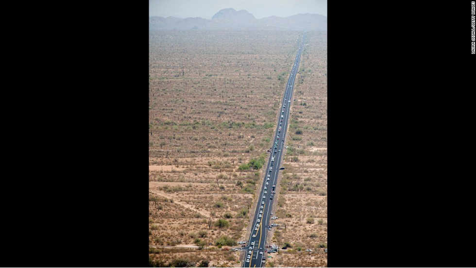 An aerial view shows the procession on the 100-mile trip from the Medical Examiner's office in Phoenix to the firefighters' home base in Prescott on July 7.