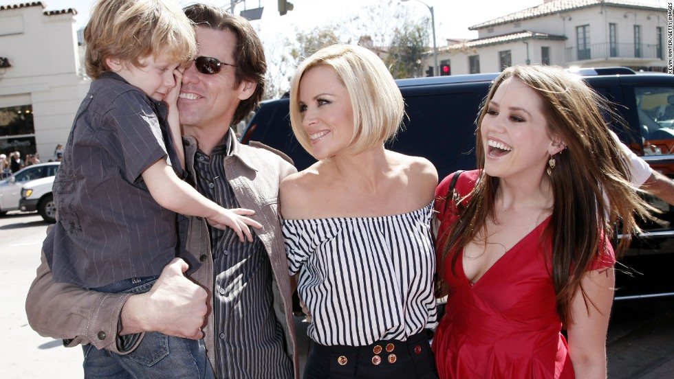 "Carrey holds Jenny McCarthy's son, Evan Asher, as he attends the 2008 premiere of ""Horton Hears a Who"" with then-girlfriend McCarthy and Carrey's daughter Jane."