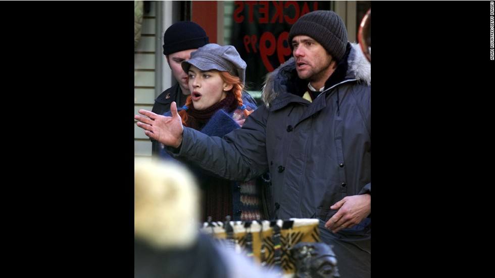 "Carrey joins co-star Kate Winslet on the set of ""Eternal Sunshine of the Spotless Mind"" in New York City in 2003."