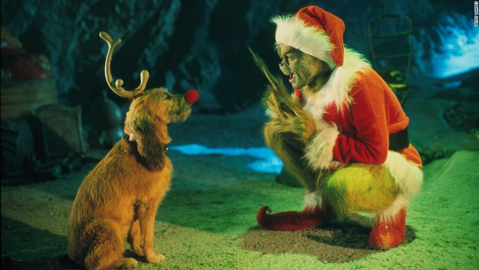 "The Grinch, played by Carrey, conspires with his dog Max in Dr. Seuss' ""How the Grinch Stole Christmas."""