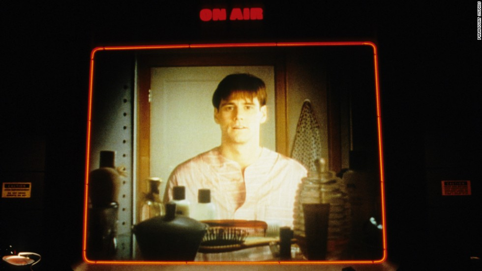 "Carrey plays the lead role in ""The Truman Show,"" a movie about a man who unknowingly lives his entire life on a studio set."