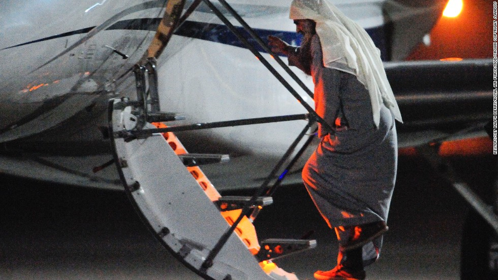 Abu Qatada boards a small aircraft bound for Jordan on July 7, ending eight years of government efforts to send him home for trial on charges of alleged terrorism.