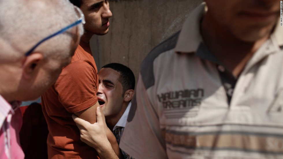 A man reacts after seeing the body of a family member at the Liltaqmeen al-Sahy Hospital in Cairo, allegedly killed during a sit-in supporting Morsy in front of the Republican Guard headquarters on July 8.
