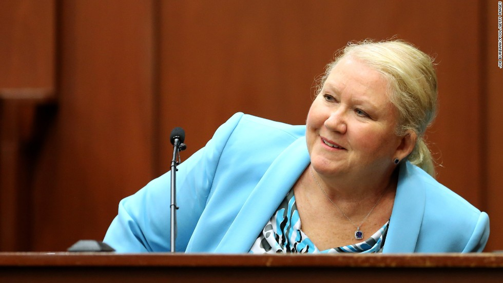 Leanne Benjamin, a friend of Zimmerman's, smiles while identifying him in court on July 8.