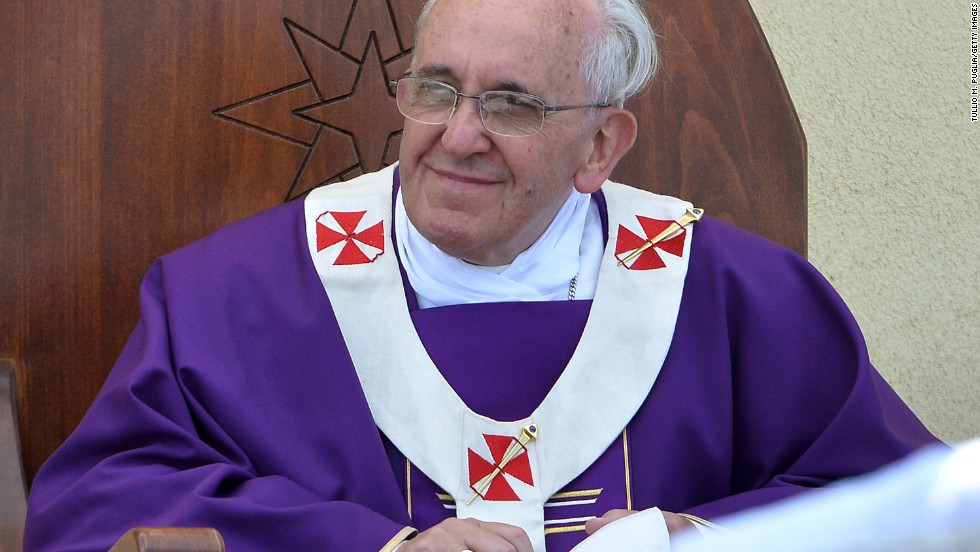 "The pope held a mass for 15,000 people under blazing sun at an outdoor sporting center on the island. Standing at an altar made of the wooden remnants of refugee boats and dressed in purple robes normally reserved for lent and mourning, Pope Francis gave an emotional homily focused on ""global indifference"" to the refugee and irregular migrant problem."