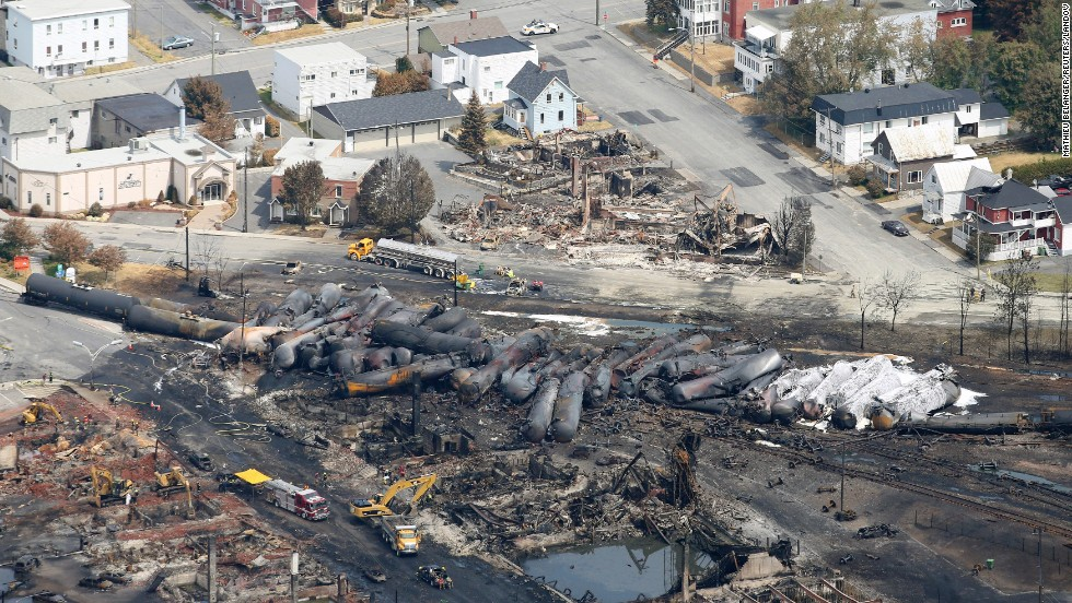 Burned tanker cars are scattered on the tracks in Lac-Megantic, Quebec, on Monday, July 8.