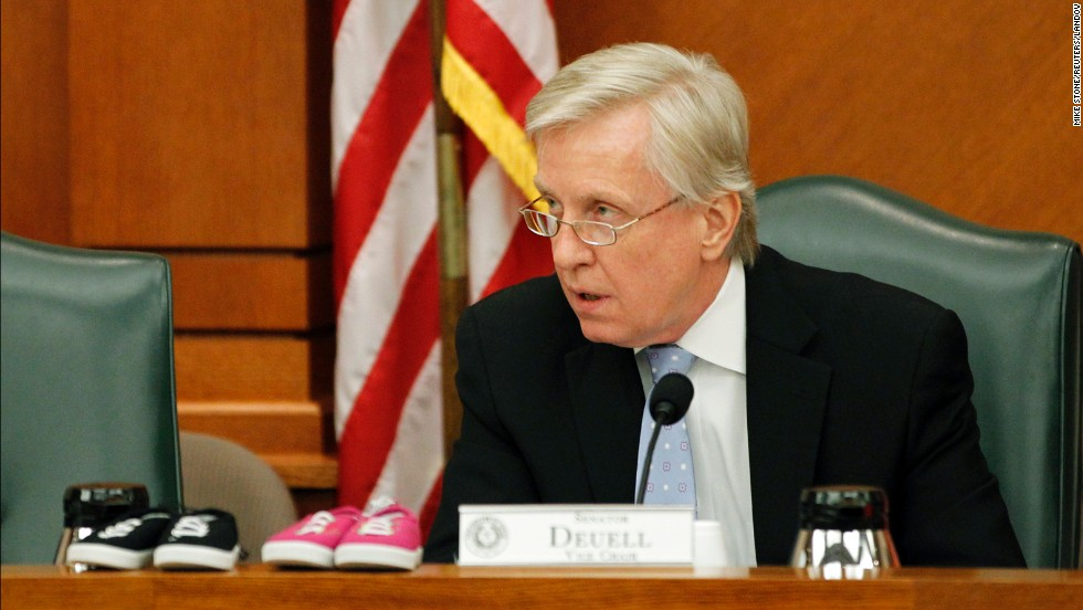 Republican Sen. Bob Deuell set two pairs of infant shoes on the counter while speaking at a Senate hearing July 8.