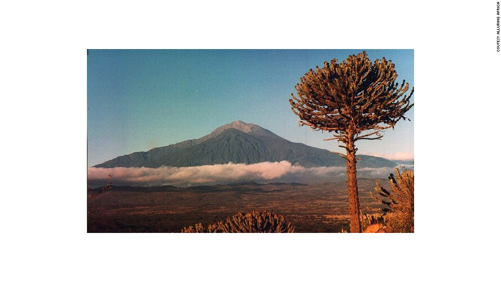 Mount Meru is a beautiful extinct volcano that's often used by mountaineers for acclimatization before trekking Kilimanjaro. <em>Peak: 4,565 meters.</em>