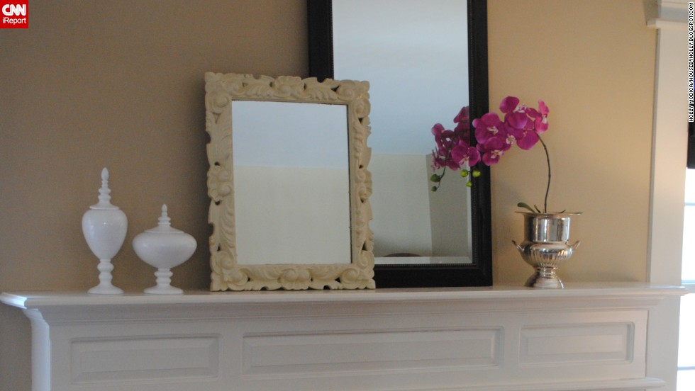 "<a href=""http://ireport.cnn.com/docs/DOC-1000852"">Holly Modica</a> of Middletown, Connecticut, used mirrors on her mantel to add whimsy and interest and to highlight the room's height."