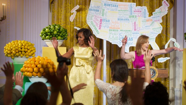 "First lady Michelle Obama and Editor-in-Chief of Epicurious.com Tanya Steel start off the Kids' ""State Dinner"" by perfoming the wave with those in attendance.  Fifty-four children along with their parent or gaurdian attended as winners of the""Healthy Lunchtime Challenge"" from their state or territory."