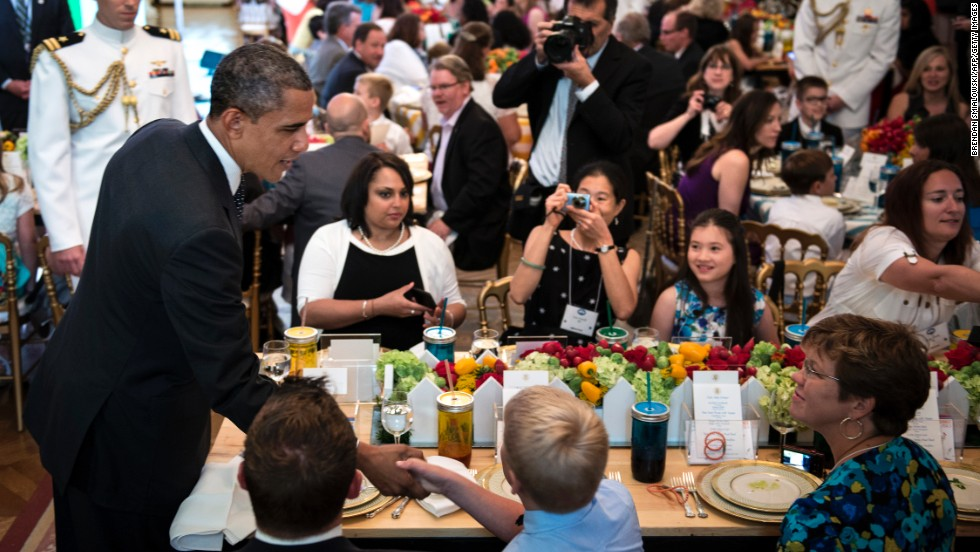 President Obama greets guests during the dinner.