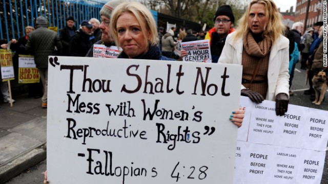 A protester displays a banner against Ireland's abortion laws in Dublin on November 24.