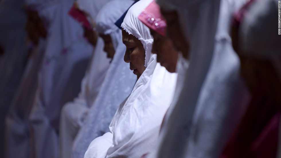 JULY 10 - JAKARTA, INDONESIA: Women hold prayers on the first night of the holy month of Ramadan at the Istiqlal mosque in Jakarta. Islam's holy month of Ramadan is marked by fasting, abstaining from foods, sex and smoking from dawn to dusk for soul cleansing and strengthening the spiritual bond between them and the Almighty.