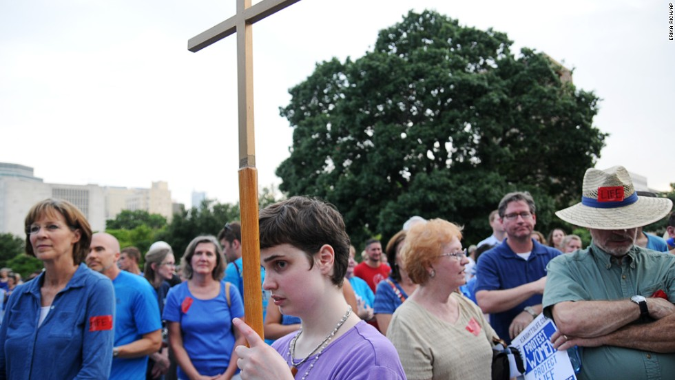 Supporters of the bill listen to speakers July 8 at a rally organized by the Texas Right to Life Organization.