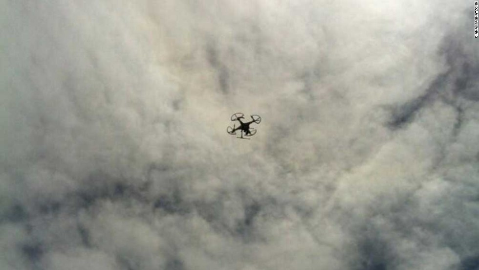 "A remote-controlled ""octocopter"" belonging to the CNN team takes to the skies for an aerial shot of the mountain trail."