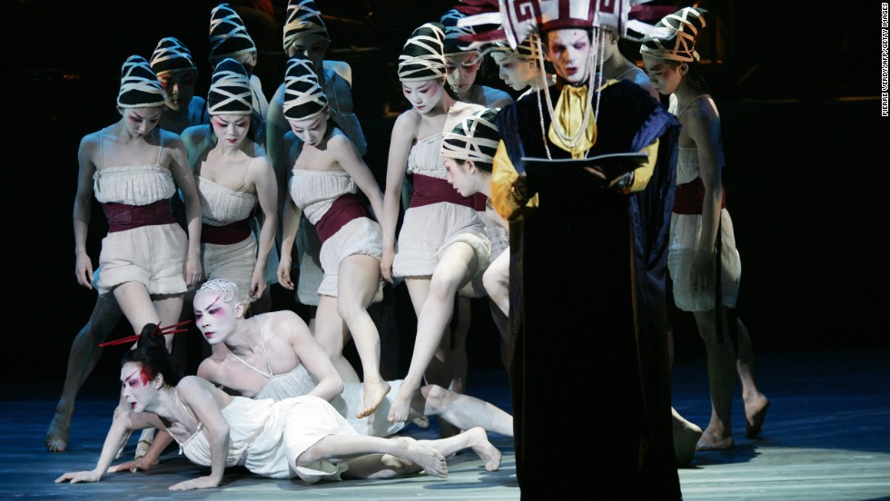 Jin Xing, lower left,  performs in June 2005 at the Palais des Congres in Paris during the rehearsal of the symphonic dance 'Carmina Burana'.