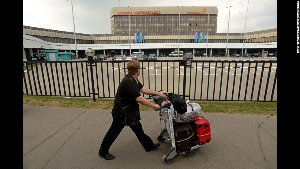 "A man walks past Terminal F of Moscow's Sheremetyevo International Airport, where <a href=""http://www.cnn.com/2013/06/10/politics/edward-snowden-profile/index.html?iid=article_sidebar"">U.S. intelligence leaker Edward Snowden </a>has been holed up since arriving June 23 from Hong Kong. The ex-National Security Agency contractor has admitted leaking classified documents about U.S. surveillance programs and faces espionage charges in the United States. In his first public appearance since arriving at Sheremetyevo, <a href=""http://www.cnn.com/2013/07/12/world/europe/russia-us-snowden/index.html"">Snowden met with human rights activists and lawyers </a>Friday, July 12, in the airport's transit zone. While it's still not clear if Russia will grant Snowden's temporary asylum request, he can leave the airport, Russian media report."