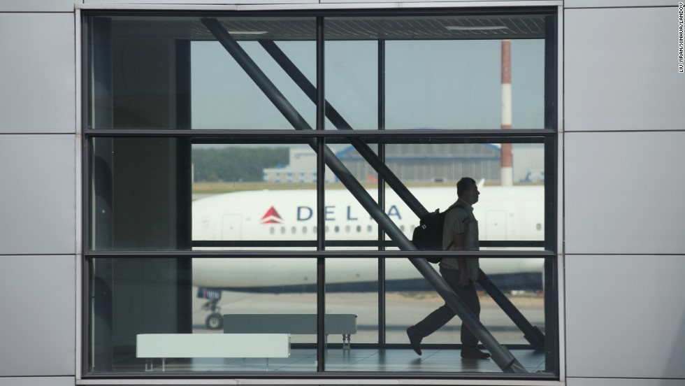 A passenger walks between terminals D and E on July 5.